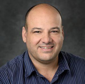 Portrait photo of Gustavo de los Campos