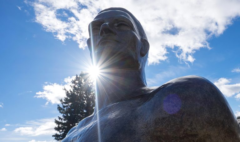 Image of Spartan statute on sunny day with blue sky