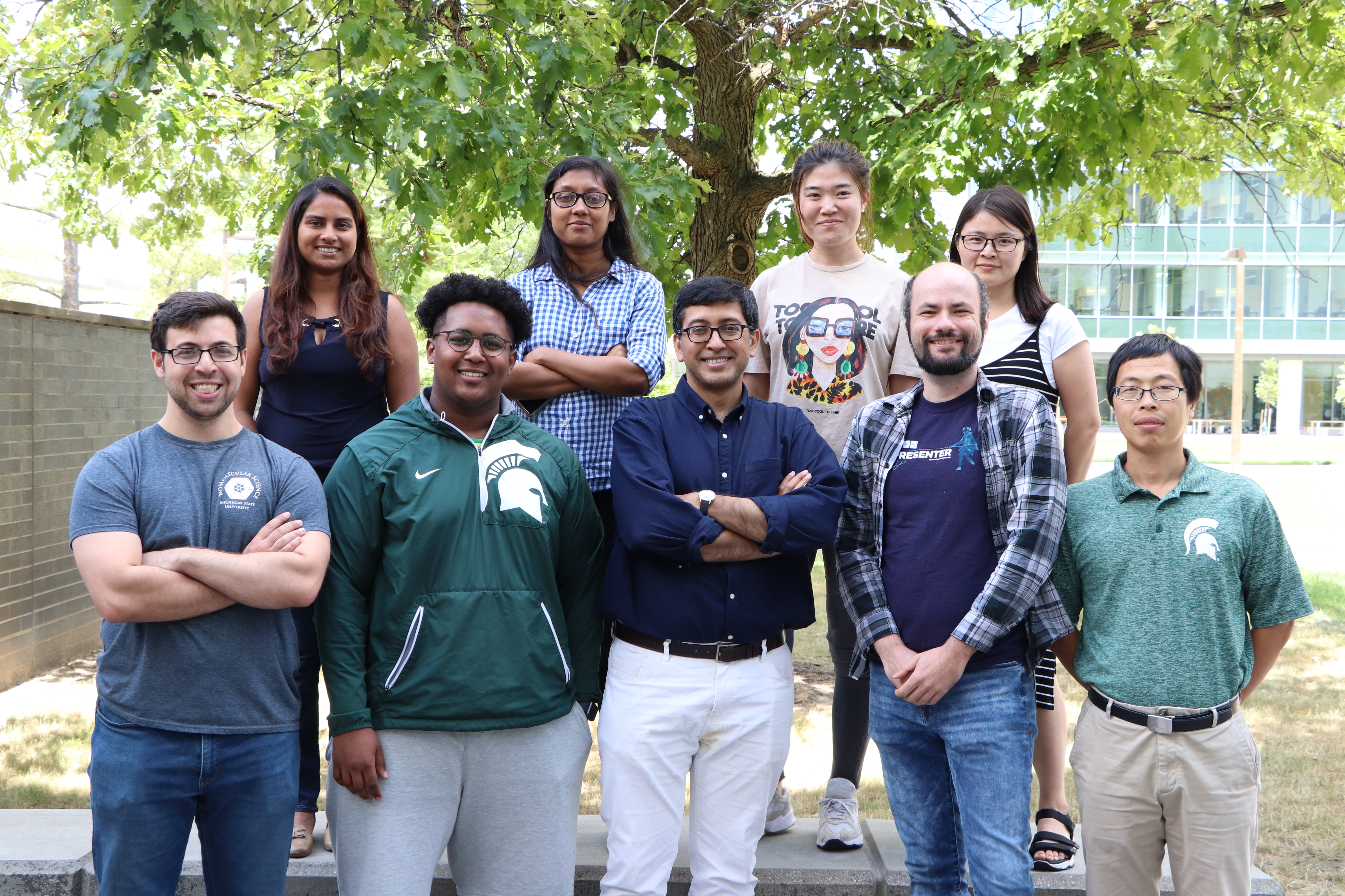 Photo of the Bhattacharya lab standing outside of the IQ building